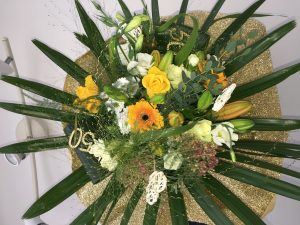 6d1f9c6a6638d Golden gerbera yellow and white roses, lisianthus foliage to add textures  finished with golden colour accessories. £45. Ruby wedding arrangement